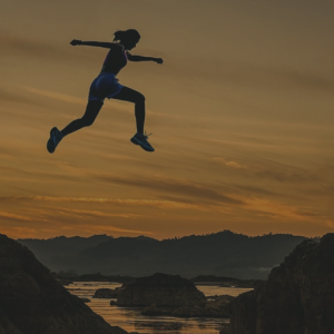 Failure: Woman in mid air leaping across a river