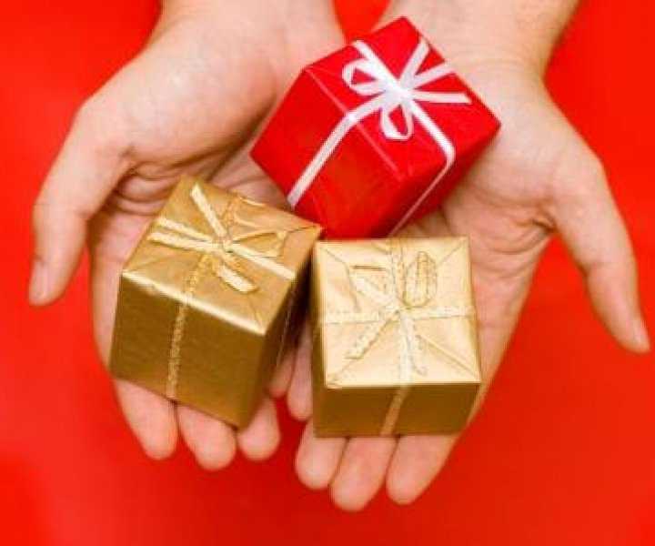 hands giving presents