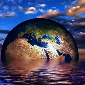 Innate Leaders - globe emerging out of the water